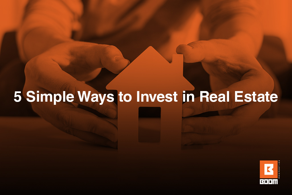 5 Simple Ways to Invest in Real Estate - person holding a small house