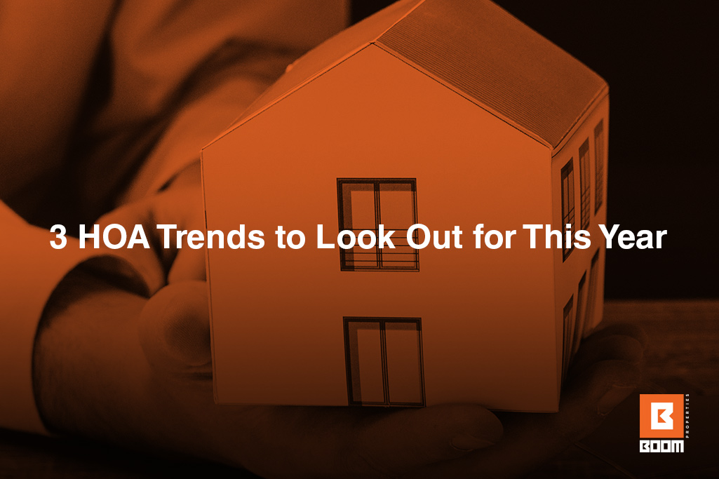 3 HOA Trends to Look Out for This Year - small house, cardboard house, in a hand