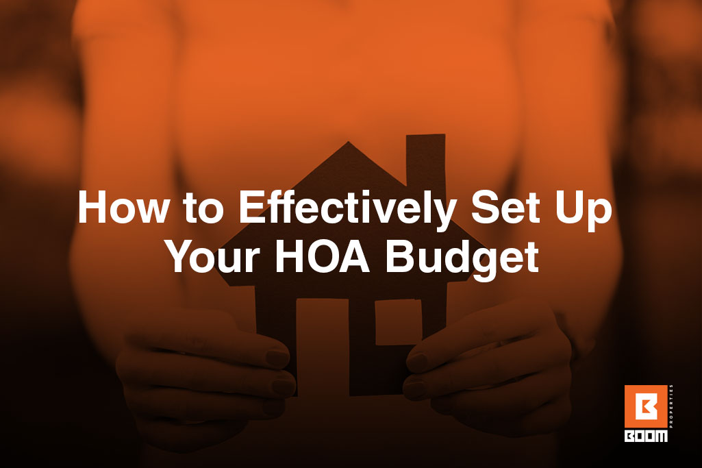 How to Effectively Set Up Your HOA Budget - a person holding a small house cutout