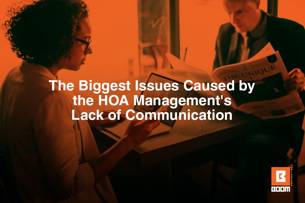 HOA management's lack of communication - two people at the table, one using laptop and the other reading newspapers