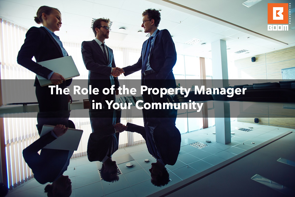 The Role of the Property Manager in Your Community - three people at the office meeting