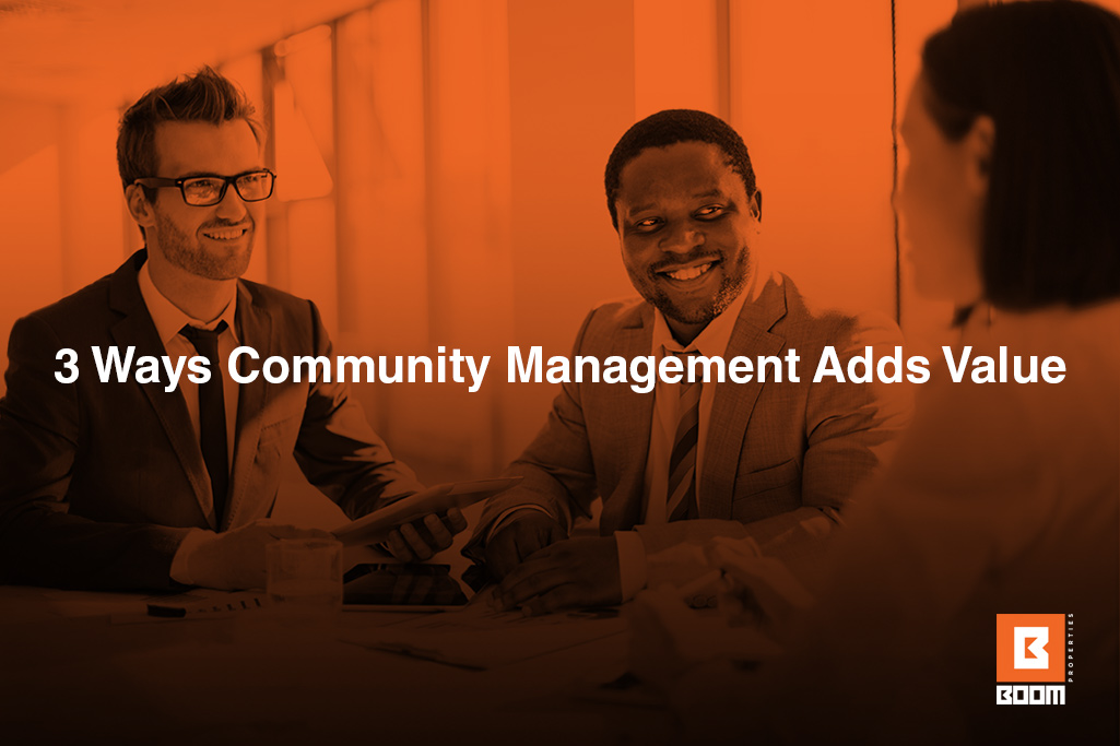 3 Ways Community Management Adds Value - 3 professional people talking, meeting