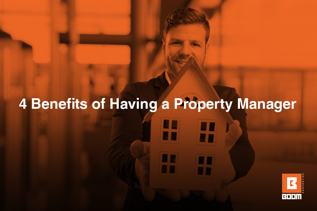 4 Benefits of Having a Property Manager - person holding a model of a house